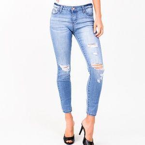 Light blue wash distressed skinny jeans
